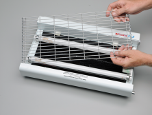 Carefully remove the front grill by slightly bending the tabs at the base of the grill outward from the punched holes and pull away.